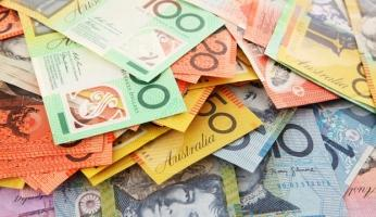 RBA cuts, but aussie won't stay down; dollar recovers