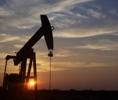 Oil prices near flat after falling more than 3% overnight