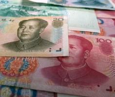 Yuan, aussie dollar slip on weak inflation data, business confidence