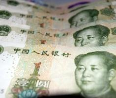 Yuan little changed despite positive PMI data
