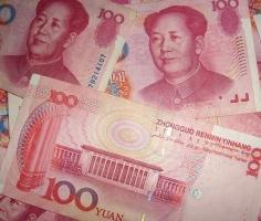 Yuan trades lower amid renewed trade concerns